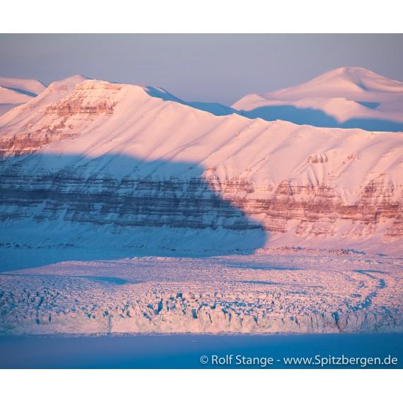Foto med Svalbard-drivved-bilderamme: bre og fjell i Tempelfjorden